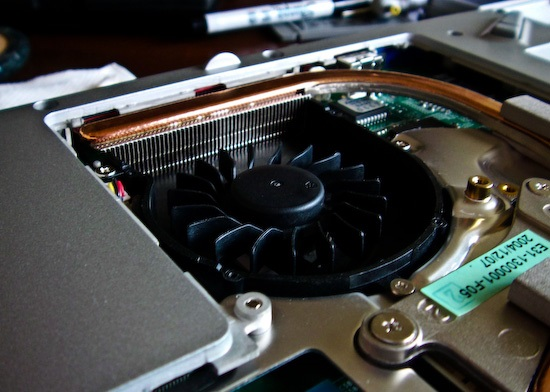 Cleaning the cooling components of a typical laptop.